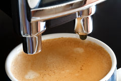 Coffee from espresso machine Royalty Free Stock Photo