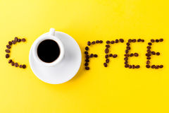 Coffee espresso in small white ceramic cup with coffee beans and royalty free stock image