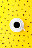 Coffee espresso in small white ceramic cup with many coffee bean Stock Photography
