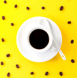 Coffee espresso in small white ceramic cup with many coffee bean Royalty Free Stock Photo