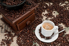 Coffee Expresso. Cup of Expresso Coffee with old grinder and coffee beans royalty free stock images