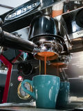 Coffee extraction process from professional espresso machine Royalty Free Stock Images
