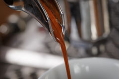 Coffee extraction process from professional espresso machine Royalty Free Stock Photography