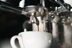 Coffee extraction process from professional espresso machine Stock Photos
