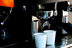 Coffee extraction from professional coffee machine. With bottomless filter royalty free stock photo