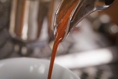 Coffee extraction from professional coffee machine. Toned photo Royalty Free Stock Image