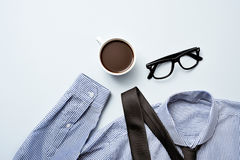 Coffee, eyeglasses, tie and shirt Stock Image