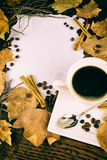 Coffee and fall leaves Royalty Free Stock Image