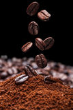 Coffee. Falling brown roasted coffee beans Royalty Free Stock Photos