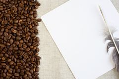 Coffee and feather Royalty Free Stock Image