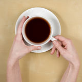 Coffee-female hands holding a cup of coffee Stock Photos