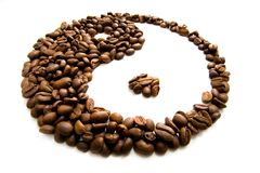 Coffee feng shui. Coffee grains lying in the shape of feng shui simbol royalty free stock image
