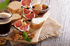 Coffee with figs and cheese bruschetta Stock Photos