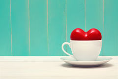 Coffee filled with love on vintage style teal wood