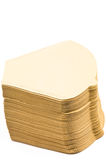 Coffee filter. A pile on unbleached coffee filter on white background Royalty Free Stock Photo