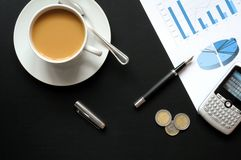 Coffee and financial data Royalty Free Stock Photos