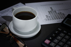Coffee and financial news. Royalty Free Stock Images