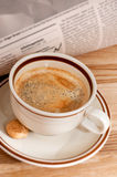 Coffee and financial newspaper Royalty Free Stock Images