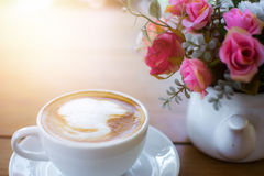 Coffee and flower on wood table Stock Photo