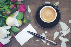 Coffee and flowers Stock Images