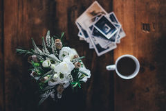 Coffee and flowers on old wood desk