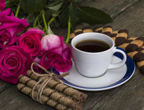 Coffee, flowers pink and cookies of two types Stock Photo