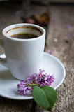 Coffee and flowers on the table Royalty Free Stock Image