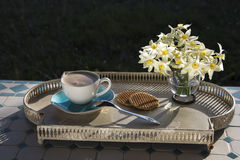 Coffee and flowers. On a tray in summer day Royalty Free Stock Photography