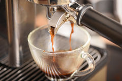 Coffee flowing into a cup. From espresso machine Stock Photo