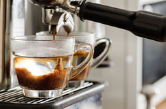 Coffee flowing into the cup. From coffee machine Royalty Free Stock Image