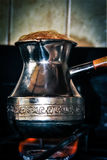 Coffee. With foam in turkey on fire Royalty Free Stock Photo