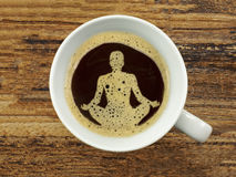 In coffee foam a wellness symbol. In a hot coffee foam a wellness symbol Stock Photos
