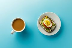 Coffee and food. top view. hot drink and sandwich on a plate royalty free stock images