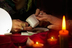 Coffee fortune telling by old gypsy fortune teller Stock Image
