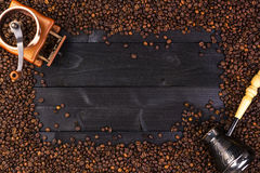 Coffee frame, top view with copy space. Ground coffee, mill, bowl of roasted coffee beans on dark wooden background Stock Photography