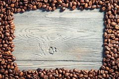 Coffee frame on wooden table Stock Image