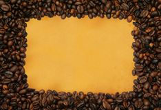 Coffee frame on yellowed paper Stock Photos