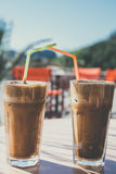 Coffee frappe, greek cuisine on the table at the beach. Vintage look Royalty Free Stock Image
