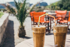Coffee frappe, vintage look. Coffee frappe, greek cuisine on the table at the beach, vintage look royalty free stock images