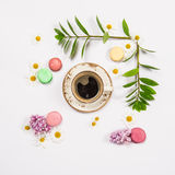 Coffee, french cookies macaroons, spring flowers Stock Photography