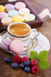 Coffee and French macaroons Stock Image