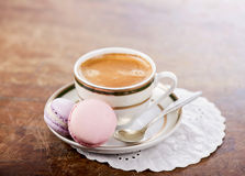 Coffee and French macaroons Stock Photography