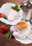 Coffee and French macaroons Stock Images