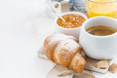 Coffee with fresh croissant, orange juice and jam. Horizontal Royalty Free Stock Photo