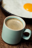 Coffee and fried egg Royalty Free Stock Image