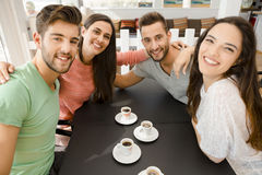 A coffee with friends. Friends having a great day at the local coffee shop royalty free stock photos