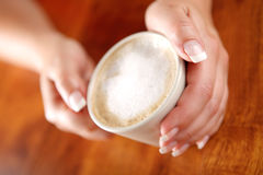 Coffee with frothed milk in hands (shallow Dof) Stock Images