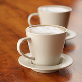 Coffee with frothed milk (shallow Dof) Stock Image