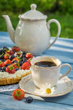 Coffee and fruit tart for dessert Royalty Free Stock Photo
