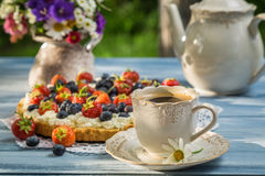 Coffee and fruit tarts served in the garden Royalty Free Stock Photo